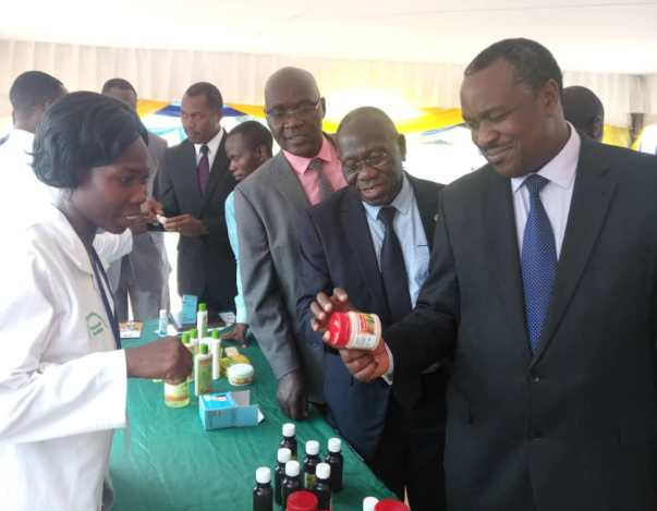 Hon.Minister Dr. Elioda Tumwesigye admiring a product made at MUST
